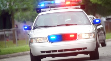 Police car patrolling city streets